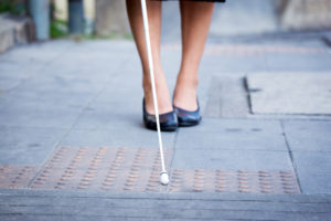 Woman walking with white stick
