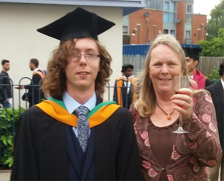 Time bank member and her son at the graduation ceremony.
